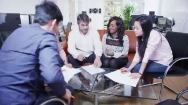 Business people in a light and modern open plan office space — Stock Video
