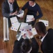View from above of busy team of architects or engineers in a meeting — Stock Video #45620241