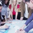 Global business team examining a map of the world — Stock Video #45620503