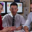 Attractive mixed ethnicity business team take a conference call — Stock Video