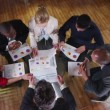 View from above of mixed ethnicity business team in a meeting — Stock Video #45622551
