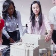 Dynamic young architects in a business meeting — Stock Video #45625435