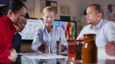 Attractive diverse marketing team in a meeting, discuss branding of products — Stock Video