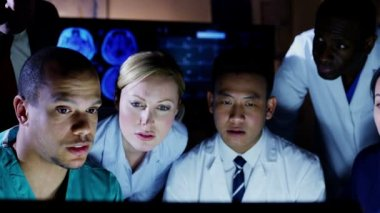 Diverse group of medical professionals working together late into the night — Stock Video