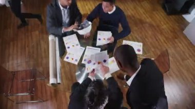 View from above of busy team of architects or engineers in a meeting — Stock Video