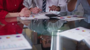 Business team in meeting, hands reach across the table to shake hands on a deal — Stock Video
