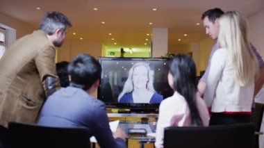Young professional business team in a meeting via video call — Stock Video