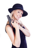 Young pretty blond woman with a gun — Stock Photo