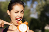 Young pretty woman with clock — Stok fotoğraf