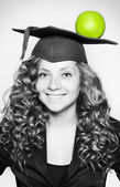 Young caucasian student with an apple on her head — Stock Photo