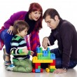 Family of three playing lego — Stock Photo