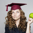 Stock Photo: Young caucasistudent with apple