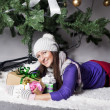 Young woman near xmas tree with presents — Stock fotografie #38328469