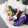 Young woman near xmas tree with presents — Stock fotografie #38328483