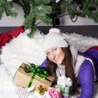 Young woman near xmas tree with presents — Stock Photo