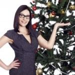 Pretty business woman near christmas tree — Stock Photo