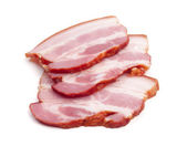 Slices of cured bacon - cut out on white — Stock Photo