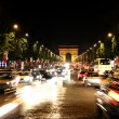 champs-elysees avenue with arc de triomphe in paris — Stock Photo