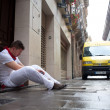 Stock Photo: PAMPLONA, SPAIN -JULY 8:unidentified msleeps on street