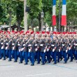 Stock Photo: PARIS - JULY 14: Army columns marching at military parade in t
