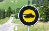 Road sign with a picture of tank — Stock Photo