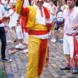 Stock Photo: PAMPLONA, SPAIN -JULY 6: Min suit toreodor having fun at th