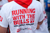 PAMPLONA, SPAIN -JULY 8: The man in the original T-shirt at the — Stock Photo