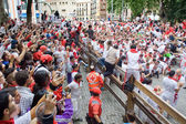 PAMPLONA, SPAIN -JULY 8: Spectators and participants of the race — Stock Photo