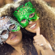 RIO DE JANEIRO - FEBRUARY 10: Two girls in masks in stands on ca — Stock Photo