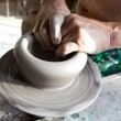 Hands of a potter manufactures clay pot — Stock Photo