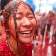 Bunol, Spain - August 28: The girl in crushed tomatoes laughs on — Stock Photo