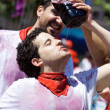 Stock Photo: PAMPLONA, SPAIN - JULY 6: Mdrinking red wine at opening of Sa