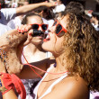 Stock Photo: PAMPLONA, SPAIN - JULY 6: Womdrinking red wine at opening of