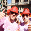 Stock Photo: PAMPLONA, SPAIN - JULY 6: Two men in red hats are posing at open