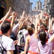 Stock Photo: PAMPLONA, SPAIN-JULY 6: People stand under spray of water at