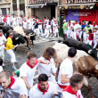 PAMPLONA, SPAIN -JULY 8: Unidentified men run from bulls in stre — Stock Photo #32668755