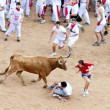 Stock Photo: PAMPLONA, SPAIN - JULY 8: People having fun with young bulls at