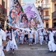 Stock Photo: PAMPLONA, SPAIN - JULY 8: People with banner walking down stre