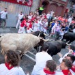 PAMPLONA, SPAIN -JULY 8: Unidentified men run from bulls in stre — Stock Photo