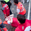 Stock Photo: PAMPLONA, SPAIN - JULY 8: Providing first aid at SFermin fest
