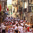 PAMPLONA, SPAIN -JULY 8: People on street  during San Fermin fes — Stock Photo
