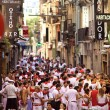 Stock Photo: PAMPLONA, SPAIN -JULY 8: People on street during SFermin fes