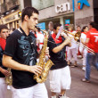 Stock Photo: PAMPLONA, SPAIN - JULY 9: Brass Band are on street during of fes