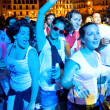 Stock Photo: PAMPLONA, SPAIN - JULY 9: People dancing in square Castillo at S