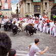 Stock Photo: PAMPLONA, SPAIN-JULY 9: Bulls and people are running in street d