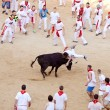 PAMPLONA, SPAIN - JULY 9: People having fun with young bulls at — Stock Photo #32669293