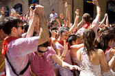 PAMPLONA, SPAIN -JULY 6: Young people having fun at opening of S — Stock Photo