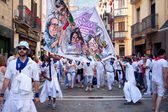 PAMPLONA, SPAIN - JULY 8: People with a banner walking down stre — Stock Photo