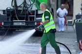 PAMPLONA, SPAIN-JULY 8: Cleaning street Estafeta to run bulls at — Stock Photo
