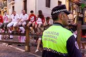 PAMPLONA, SPAIN - JULY 9: Police await start of race of bulls at — Stock Photo